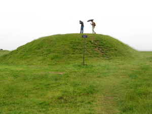 Travel and Weather: Umbrellas and Hoodies against a summer rain at the Hill of Slaine in Ireland.
